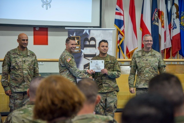A Soldier assigned to the 2d Cavalry Regiment is recognized for successfully completing all tasks and earning the Expert Field Medical Badge. Eight Dragoons from the regiment received the badge during a ceremony hosted at the Grafenwoehr Physical Fitness Center at Tower Barracks, Germany, Sept. 28, 2017.