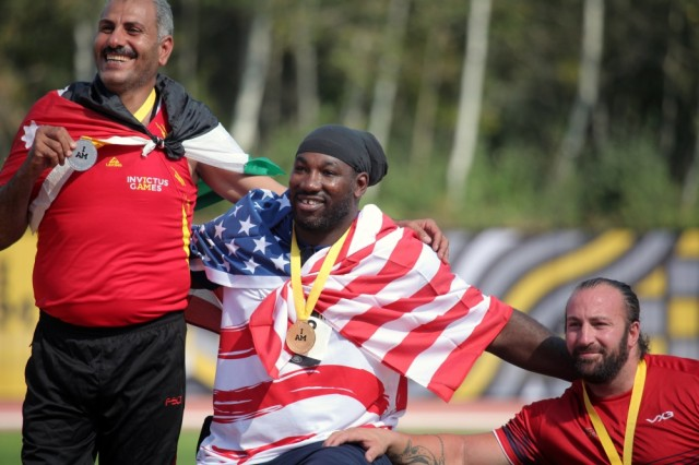 U.S. Army veteran Spc. Anthony Edward Pone sits with his fellow medalists of the men shot put 4kg event at the Invictus Games 200 meter wheelchair dash event at York Lions Stadium (YOR), Toronto, Canada, Sept. 24, 2017. The Invictus Games, Sept. 23-30, is an international program Paralympic-style, multi-sport event, created by Prince Harry of Wales, in which wounded, injured, or sick armed services personnel and their associated veterans take part in sports including wheelchair basketball, wheelchair rugby, sitting volleyball, archery, cycling, wheelchair tennis, powerlifting, golf, swimming, and indoor rowing.