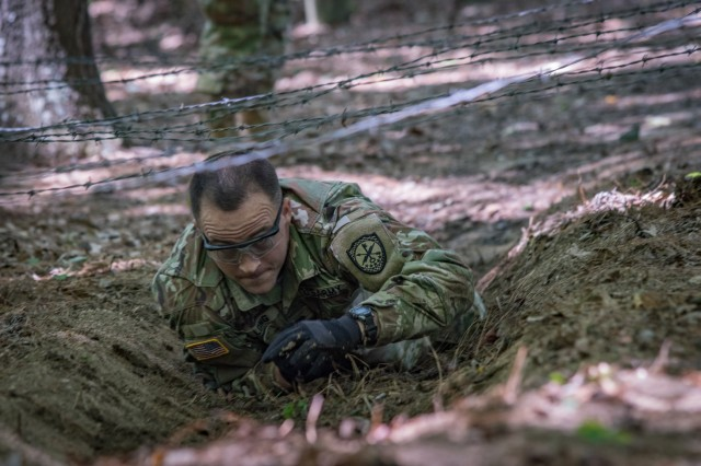 Spc. Johnny Long, assigned to Detachment Hawaii, 782nd Military Intelligence Battalion, 780th MI Brigade, works his way through an obstacle course event at the INSCOM Best Warrior Competition, Fort A.P. Hill, Virginia, July 26.