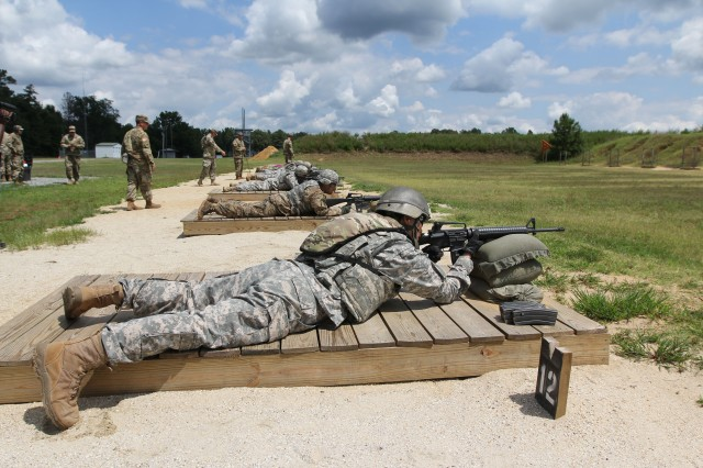 Staff Sgt. Lin Hong, assigned to the 500th Military Intelligence Brigade, engages targets during the M-16 rifle qualification event at the INSCOM Best Warrior Competition, Fort A.P. Hill, Virginia, July 27.