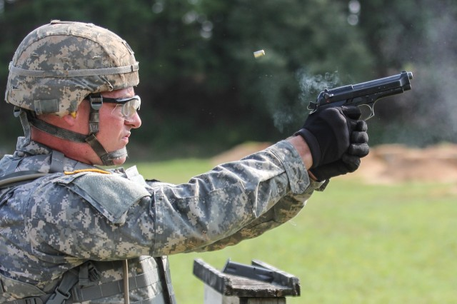 Spc. Johnny Long, a Korean linguist with the 780th Military Intelligence Brigade, engages targets during the M-9 pistol 'stress-fire' event at the INSCOM Best Warrior Competition, Fort A.P. Hill, Virginia, July 27.