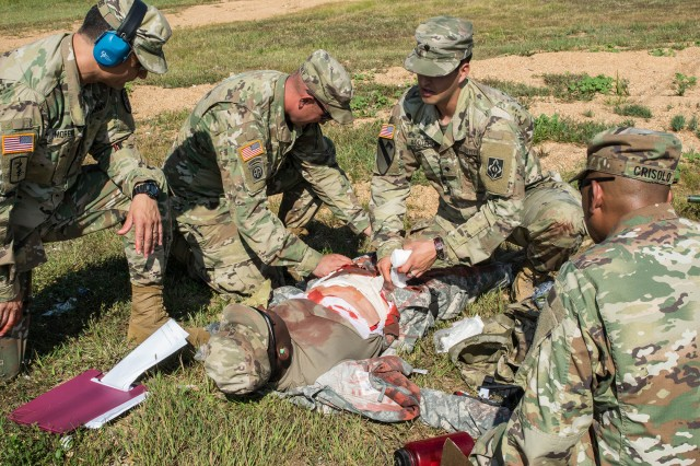 Combat Training Company's range medics respond to a simulated casualty situation during a training exercise Sept. 20 on Fort Leonard Wood's Range 4.