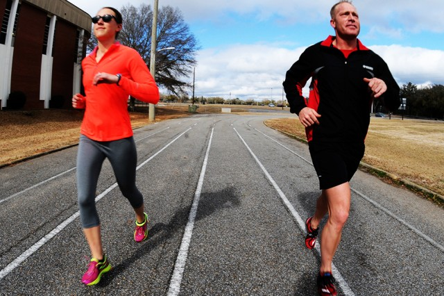 Then-W01 Adam Sniffen runs with his friend, then-1st Lt. Cierra O'Connor, at the Fort Rucker Physical Fitness Center 1/4-mile track in this file photo. The track was recently resurfaced with rubberized material to provide lower impact training for patrons.