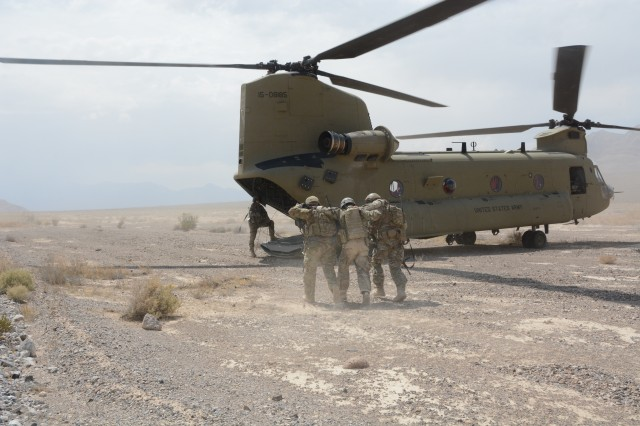 NELLIS AIR FORCE BASE, NV -- Soldiers from 10th Special Forces Group (Airborne) escort a mock casualty to a 4th Infantry Division Combat Aviation Brigade CH-47 Chinook during a training exercise on Sept. 6, 2017 at Nellis Air Force Base, Nev. Soldiers from 10th SFG (A) participated in a three-week training exercise in support of the U.S. Air Force Weapons School. The exercise is designed to enhance the interoperability of multiple air assets supporting Special Operations ground force maneuver. (U.S. Army photo by Staff Sgt. Daniel Carter)