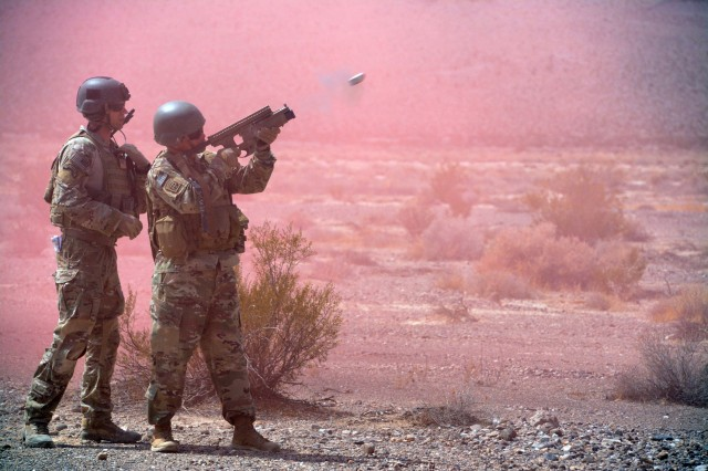 NELLIS AIR FORCE BASE, NV -- A Soldier from 10th Special Forces Group (Airborne) fires an M-203 grenade launcher during a joint air to ground integration training exercise at Nellis Air Force Base, Nev. on Sept. 6, 2017. Soldiers from 10th SFG (A) participated in a three-week training exercise in support of the U.S. Air Force Weapons School. The exercise is designed to enhance the interoperability of multiple air assets supporting Special Operations ground force maneuver. (U.S. Army photo by Staff Sgt. Jorden M. Weir)