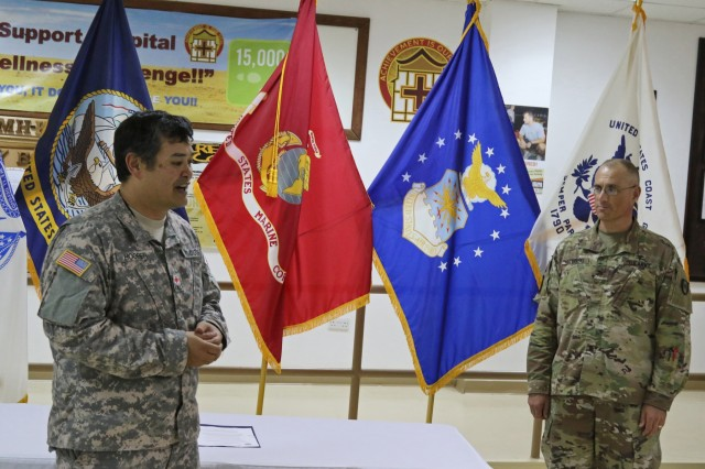 Mark Hooper (left), regional director at Camp Arifjan American Red Cross and U.S. Army Col. Bruce Syvinski (right), commander, 86th Combat Support Hospital, discuss the experiences volunteers can gain in their cooperative program on Aug. 31. Volunteers, working through the Red Cross, can gain insight into a medical field which will broader there individual skill sets.