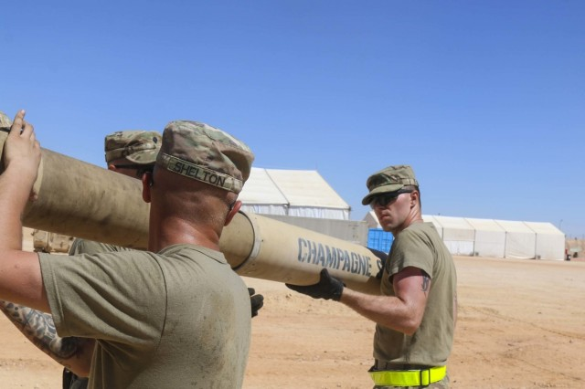 Spc. Matthew Shelton, a gunner, and Spc. Philip Roberts, a driver, both assigned to Charlie Company, 2nd Battalion, 7th Cavalry Regiment, 3rd Armored Brigade Combat Team, 1st Cavalry Division, install the gun tube after tightening the bore evacuator on an M1A2 Abrams Main Battle Tank while conducting maintenance once the vehicles arrived to the field training site of Exercise Bright Star 2017 at Mohamed Naguib Military Base, Egypt, Sept. 10. The exercise provides an opportunity to build partnership and mutual cooperation in the fight against radical terrorism in the region. (U.S. Army photo by Staff Sgt. Leah R. Kilpatrick)