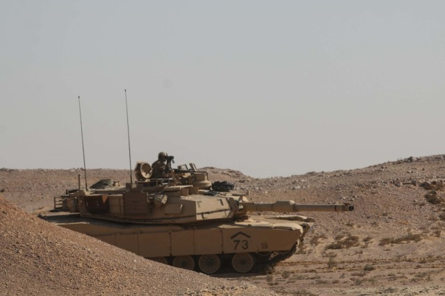"A tank commander assigned to the 2nd Battalion, 7th Cavalry Regiment, 3rd Armored Brigade Combat Team, 1st Cavalry Division looks for positive identification of the ""enemy"" from his battle position at the field training site of Exercise Bright Star 2017 in Mohamed Naguib Military Base, Egypt, Sept. 12. The exercise provides an opportunity to build partnership and mutual cooperation in the fight against radical terrorism in the region. (U.S. Army photo by Staff Sgt. Leah R. Kilpatrick)"