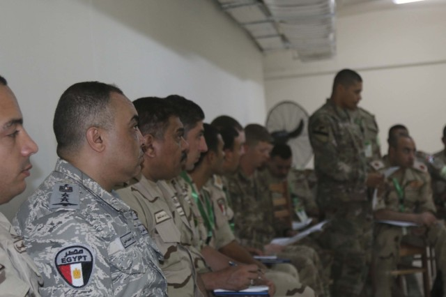 U.S. and Egyptian officers watch a combined arms rehearsal as 2nd Lt. Alan-Michael Alvarado, the assistant intelligence officer assigned to 2nd Battalion, 7th Cavalry Regiment, 3rd Armored Brigade COmbat Team, 1st Cavalry Division, briefs the intelligence update during the command-post exercise of Exercise Bright Star 2017 at Mohamed Naguib Military Base, Egypt, Sept. 12. Bright Star is a bilateral exercise between U.S. Central Command and the Arab Republic of Egypt during which about 200 U.S. personnel participated in a command-post exercise, a field training exercise and a senior leader seminar to promote and enhance regional security and cooperation. (U.S. Army photo by Staff Sgt. Leah R. Kilpatrick)