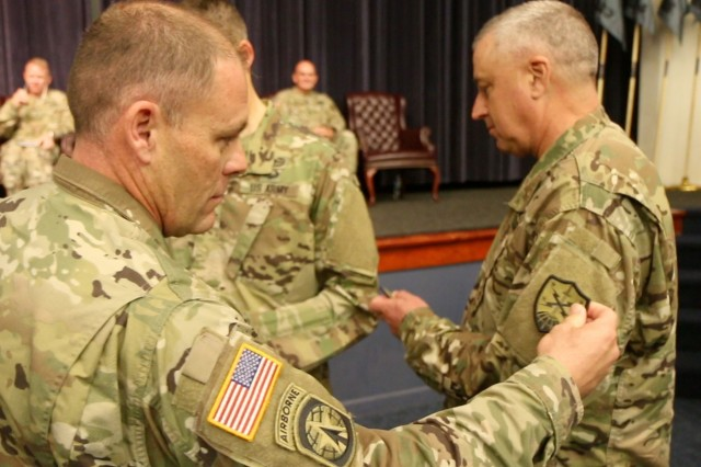 The command team of the Virginia National Guard's newly-activated Bowling Green-based 91st Cyber Brigade receive their new should sleeve insignia Sept. 17, 2017, at Fort Belvoir, Virginia.  (U.S. National Guard photo by Cotton Puryear)