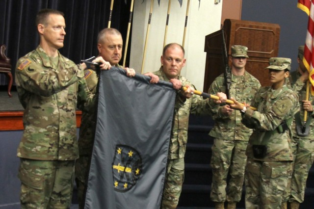 The command team for the Virginia National Guard's newly-activated Bowling Green-based 91st Cyber Brigade uncase their unit colors Sept. 17, 2017, at Fort Belvoir, Virginia, then present new shoulder sleeve insignia to Soldiers assigned to the Army National Guard's first cyber brigade. Prior to uncasing the colors, former commanders of 91st Troop Command helped the current command team case the Troop Command colors to symbolize the inactivation of the unit. The new cyber brigade provides training and readiness oversight for cyber units across 30 states. (U.S. Army National Guard photo by Staff Sgt. Matt Lyman)