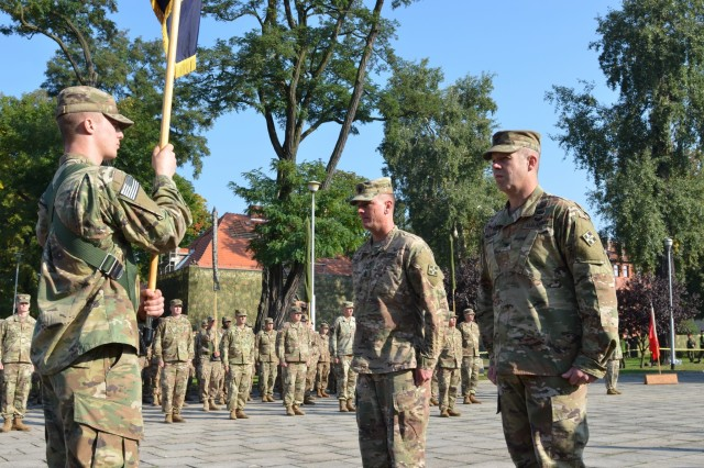 MARKET SQUARE, ZAGAN, Poland - Col. Michael Simmering, commander, 3rd Armored Brigade Combat Team, 4th Infantry Division and Command Sgt. Maj. Samuel Rapp stand at attention before the unit colors in the transfer of authority ceremony, Market Square, Zagan, Poland, Sep. 29. The brigade commander and command sergeant major prepare to case the 3rd ABCT colors in the ceremony, closing the unit's rotation. The command and responsibility of being the only armored brigade combat team in Europe transitions from 3rd ABCT to 2nd ABCT, 1st Infantry Division as the 4th Infantry Division unit prepares to return to Fort Carson. (U.S. Army photo by Sgt. Shiloh Capers)