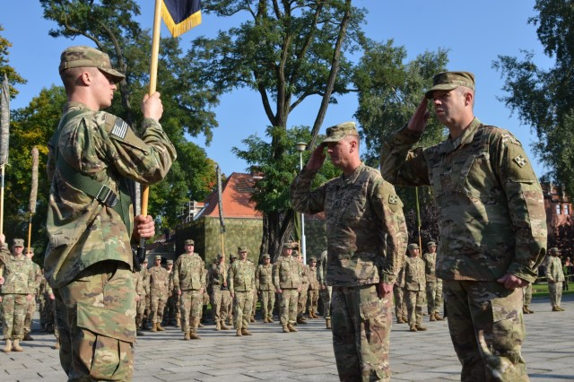 MARKET SQUARE, ZAGAN, Poland - Col. Michael Simmering, commander, 3rd Armored Brigade Combat Team, 4th Infantry Division and Command Sgt. Maj. Samuel Rapp salute the unit colors one final time during the transfer of authority ceremony, Market Square, Zagan, Poland, Sep. 29. The brigade commander and command sergeant major prepare to case the 3rd ABCT colors in the ceremony, closing the unit's rotation. The command and responsibility of being the only armored brigade combat team in Europe transitions from 3rd ABCT to 2nd ABCT, 1st Infantry Division as the 4th Infantry Division unit prepares to return to Fort Carson. (U.S. Army photo by Sgt. Shiloh Capers)