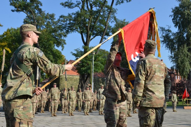 MARKET SQUARE, ZAGAN, Poland - Col. Michael Simmering, commander, 3rd Armored Brigade Combat Team, 4th Infantry Division and Command Sgt. Maj. Samuel Rapp prepare to case the 3rd ABCT colors in the transfer of authority ceremony, Market Square, Zagan, Poland, Sep. 29. The command and responsibility of being the only armored brigade combat team in Europe transitions from 3rd ABCT to 2nd ABCT, 1st Infantry Division as the 4th Infantry Division unit prepares to return to Fort Carson. (U.S. Army photo by Sgt. Shiloh Capers)
