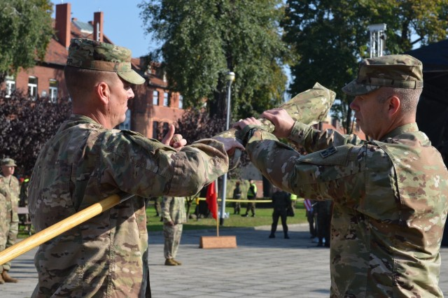MARKET SQUARE, ZAGAN, Poland - Col. Michael Simmering, commander, 3rd Armored Brigade Combat Team, 4th Infantry Division and Command Sgt. Maj. Samuel Rapp case the 3rd ABCT colors in the transfer of authority ceremony, Market Square, Zagan, Poland, Sep. 29. The command and responsibility of being the only armored brigade combat team in Europe transitions from 3rd ABCT to 2nd ABCT, 1st Infantry Division as the 4th Infantry Division unit prepares to return to Fort Carson. (U.S. Army photo by Sgt. Shiloh Capers)