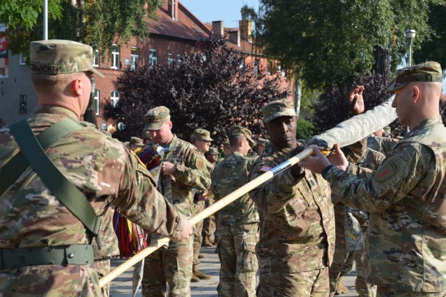 MARKET SQUARE, ZAGAN, Poland - Col. David Gardner, commander, 2nd Armored Brigade Combat Team, and Command Sgt. Maj. Craig Copridge uncase the 2nd Armored Brigade Combat Team, 1st Infantry Division unit colors during the transfer of authority ceremony, Market Square, Zagan, Poland, Sep. 29. The command and responsibility of being the only armored brigade combat team in Europe transitions from 3rd ABCT, 4th Infantry Division to 2nd ABCT as the 4th Infantry Division unit prepares to return to Fort Carson. The 2nd ABCT is currently in Poland to support Atlantic Resolve, a U.S. endeavor to fulfill NATO commitments by rotating U.S. -based units throughout the European theater and training with NATO Allies and partners. (U.S. Army photo by Sgt. Shiloh Capers)