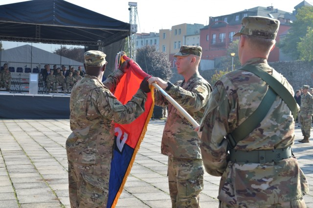 MARKET SQUARE, ZAGAN, Poland - Col. David Gardner, commander, 2nd Armored Brigade Combat Team, 1st Infantry Division and Command Sgt. Maj. Craig Copridge uncase the 2nd Armored Brigade Combat Team unit colors during the transfer of authority ceremony, Market Square, Zagan, Poland, Sep. 29. The command and responsibility of being the only armored brigade combat team in Europe transitions from 3rd ABCT, 4th Infantry Division to 2nd ABCT as the 4th Infantry Division unit prepares to return to Fort Carson. The 2nd ABCT is currently in Poland to support Atlantic Resolve, a U.S. endeavor to fulfill NATO commitments by rotating U.S. -based units throughout the European theater and training with NATO Allies and partners. (U.S. Army photo by Sgt. Shiloh Capers)