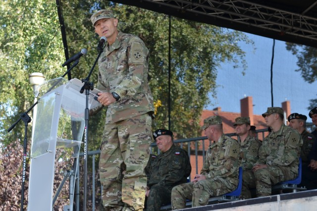MARKET SQUARE, ZAGAN, Poland - Maj. Gen. Randy A. George, division commander, 4th Infantry Division, Fort Carson, speaks during a transfer of authority ceremony, Market Square, Zagan, Poland, Sep. 29. The ceremony marks the transfer of command and responsibility of being the only armored brigade combat team in Europe from 3rd Armored Brigade Combat Team, 4th Infantry Division to 2nd Armored Brigade Combat Team, 1st Infantry Division. The 2nd ABCT is currently in Poland to support Atlantic Resolve, a U.S. endeavor to fulfill NATO commitments by rotating U.S. -based units throughout the European theater and training with NATO Allies and partners. (U.S. Army photo by Sgt. Shiloh Capers)