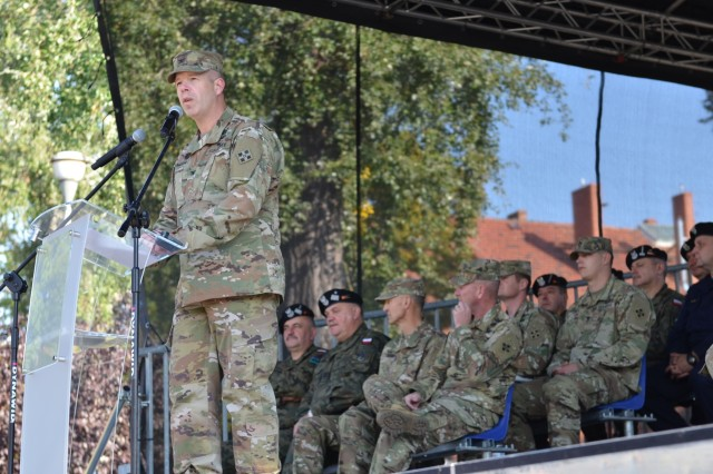 MARKET SQUARE, ZAGAN, Poland - Col. Michael Simmering, commander, 3rd Armored Brigade Combat Team, 4th Infantry Division, speaks during a transfer of authority ceremony, Market Square, Zagan, Poland, Sep. 29. The ceremony marks the transfer of command and responsibility of being the only armored brigade combat team in Europe from 3rd Armored Brigade Combat Team to 2nd Armored Brigade Combat Team, 1st Infantry Division. The 2nd ABCT is currently in Poland to support Atlantic Resolve, a U.S. endeavor to fulfill NATO commitments by rotating U.S. -based units throughout the European theater and training with NATO Allies and partners. (U.S. Army photo by Sgt. Shiloh Capers)
