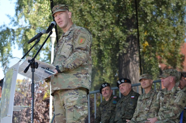 MARKET SQUARE, ZAGAN, Poland - Col. David Gardner, commander, 2nd Armored Brigade Combat Team, 1st Infantry Division, speaks during a transfer of authority ceremony, Market Square, Zagan, Poland, Sep. 29. The ceremony marks the transfer of command and responsibility of being the only armored brigade combat team in Europe from 3rd Armored Brigade Combat Team. 4th Infantry Division to 2nd Armored Brigade Combat Team. The 2nd ABCT is currently in Poland to support Atlantic Resolve, a U.S. endeavor to fulfill NATO commitments by rotating U.S. -based units throughout the European theater and training with NATO Allies and partners. (U.S. Army photo by Sgt. Shiloh Capers)