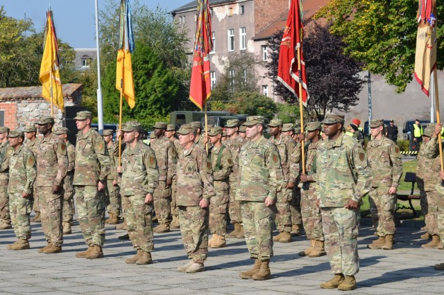 MARKET SQUARE, ZAGAN, Poland- Soldiers of the 2nd Armored Brigade Combat Team, 1st Infantry Division, stand in formation during a transfer of authority ceremony, Market Square, Zagan, Poland, Sep. 29. The ceremony marks the transfer of command and responsibility of being the only armored brigade combat team in Europe from 3rd Armored Brigade Combat Team to 2nd Armored Brigade Combat Team. The 2nd ABCT is currently in Poland to support Atlantic Resolve, a U.S. endeavor to fulfill NATO commitments by rotating U.S. -based units throughout the European theater and training with NATO Allies and partners The (U.S. Army photo by Sgt. Shiloh Capers)