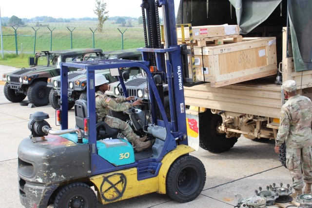 Spc. Brittney Robinson, an issue clerk, assigned to Alpha Troop, Regimental Support Squadron, 2d Cavalry Regiment, loads class IX repair parts onto a customers truck at the Supply Support Activity warehouse on Rose Barracks, Germany Sept. 21 2017 during the Supply Excellence Award Inspection. The automated logistics specialist helped her platoon win the U.S. Army Europe Supply Excellence Award Level IV SSA (MTOE).