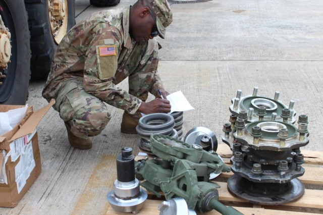 Sgt. Babatunde Babayemi, noncommissioned officer for the turn-in section, reviews a customer's Class IX recoverable parts during the Supply Excellence Award inspection Sept. 21, 2017 at the Supply Support Activity warehouse on Rose Barracks, Germany. The automated logistics specialist helped his platoon win the U.S. Army Europe Supply Excellence Award Level IV SSA (MTOE).