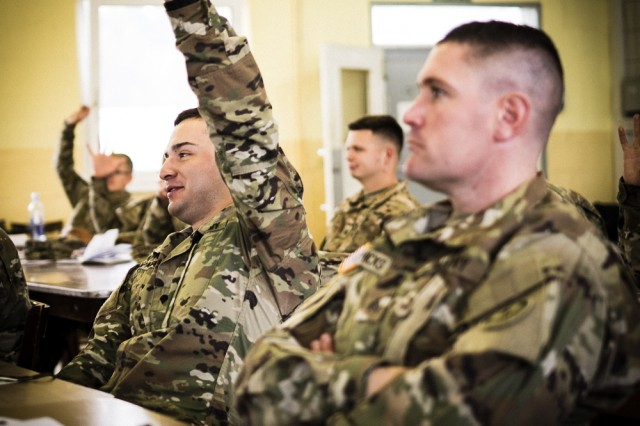 Spc. Luis Zapata, a horizontal construction engineer assigned to Regimental Engineer Squadron, 2d Cavalry Regiment, eagerly raises his hand to answer a question during the Team Leader Academy on Sept. 21, 2017 at Camp Aachen, Grafenwhoer Training Area, Germany. The Team Leader Academy, conducted Sept. 18 -- 22, is a challenging training event for junior enlisted Soldiers where they learn the fundamentals of becoming a military leader.