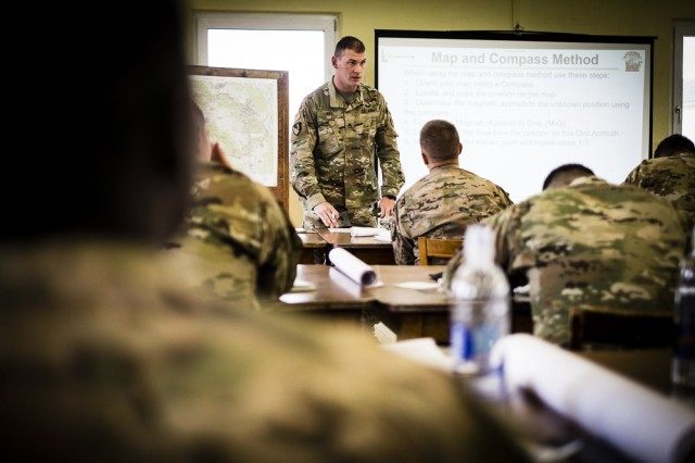 Staff Sgt. Andrew Nee, primary instructor for the Regimental Engineer Squadron, 2d Cavalry Regiment Team Leader Academy, instructs students about land navigation at Camp Aachen, Grafenwhoer Training Area, Germany, Sept. 21, 2017. The Team Leader Academy, conducted Sept. 18 -- 22, is a challenging training event for junior enlisted Soldiers where they learn the fundamentals of becoming a military leader.