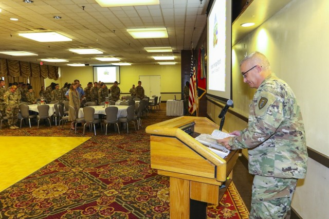 Chaplain (Maj.) Clifford Newman, with 71th Ordnance Group (explosive ordnance disposal), gives an invocation for the 2017 Hispanic Heritage Month observance, presented by 71st OD GP (EOD) and 4th Infantry Division's Equal Opportunity Office, Sept. 25 at the Elkhorn Conference Center. The observance officially began Sep. 15 and will continue through Oct. 15. (U.S. Army photo by Staff Sgt. Lance Pounds, 71st Ordnance Group (EOD), Public Affairs)