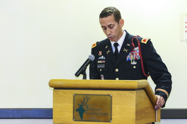 Col. Norberto Menendez (right), commander of 4th Infantry Division Artillery and guest speaker, gives a speech to Fort Carson Soldiers attending the 2017 Hispanic Heritage Month observance, presented by 71st Ordnance Group (Explosive Ordnance Disposal) and 4th Infantry Division's Equal Opportunity Office, Sept. 25 at the Elkhorn Conference Center. The observance officially began Sep. 15 and will continue through Oct. 15. (U.S. Army photo by Staff Sgt. Lance Pounds, 71st Ordnance Group (EOD), Public Affairs)