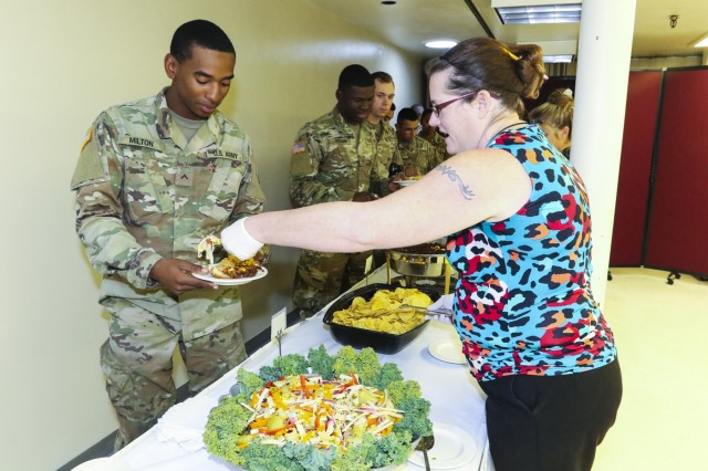 Soldiers of Fort Carson indulge in some Hispanic inspired cuisine during the 2017 Hispanic Heritage Month observance, presented by 71st Ordnance Group (Explosive Ordnance Disposal) and 4th Infantry Division's Equal Opportunity Office, Sept. 25 at the Elkhorn Conference Center. The observance officially began Sep. 15 and will continue through Oct. 15. (U.S. Army photo by Staff Sgt. Lance Pounds, 71st Ordnance Group (EOD), Public Affairs)