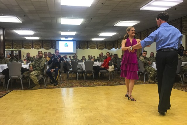 Brad Ackerman, founder and owner of a local dance studio, and his spouse demonstrate popular Hispanic inspired dance arrangements during the 2017 Hispanic Heritage Month observance, presented by 71st Ordnance Group (Explosive Ordnance Disposal) and 4th Infantry Division's Equal Opportunity Office, Sept. 25 at the Elkhorn Conference Center. The observance officially began Sep. 15 and will continue through Oct. 15. (U.S. Army photo by Staff Sgt. Lance Pounds, 71st Ordnance Group (EOD), Public Affairs)