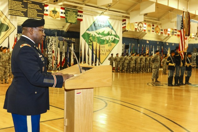 "Col. Frank David II, commander of 71st Ordnance Group (Explosive Ordnance Disposal), gives a speech about eight Soldiers to be honored for their many years of dedicated service to the nation during a post retirement ceremony Sept. 27, 2017, inside the William ""Bill"" Reed special events center at Fort Carson, Colo. The ceremony is held each month to show appreciation for Soldiers exiting the military and allows friends, family members and coworkers an opportunity to celebrate in the Soldiers' decades-long achievements. (U.S. Army photo by Staff Sgt. Lance Pounds, 71st Ordnance Group (EOD), Public Affairs)"