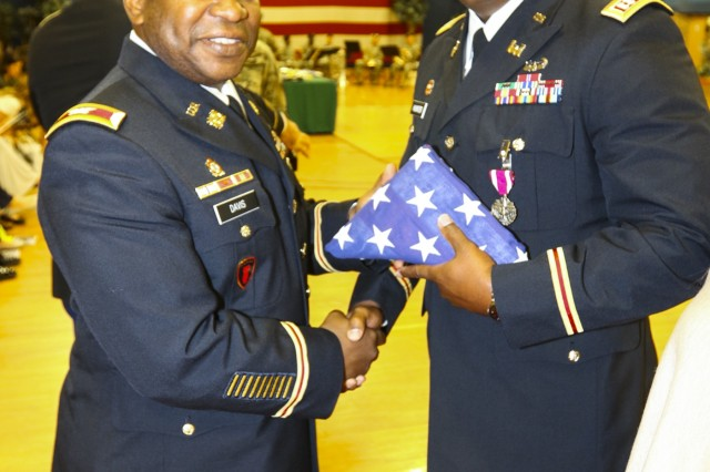 "Col. Frank Davis II, commander of 71st Ordnance Group (Explosive Ordnance Disposal), poses for a photo with Capt. Tyrone Hunter, assigned to 4th Infantry Division, during a post retirement ceremony Sept. 27, 2017, inside the William ""Bill"" Reed special events center at Fort Carson, Colo. Hunter was one of eight retirees honored at the ceremony. The ceremony is held each month to show appreciation for Soldiers exiting the military and allows friends, family members and coworkers an opportunity to celebrate in the Soldiers' decades-long achievements. (U.S. Army photo by Staff Sgt. Lance Pounds, 71st Ordnance Group (EOD), Public Affairs)"