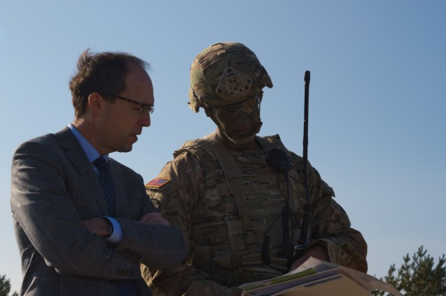 U.S. Army Col. James Bartholomees, brigade commander of the 173rd Airborne Brigade, briefs Paul Poletes, Deputy Chief of Mission of the U.S. Embassy in Latvia, on the day's events during a combined arms live fire exercise at Adazi Training Area, Latvia on Oct. 2, 2017.