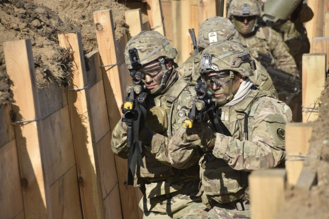 U.S. Soldiers assigned to Battle Group Poland and 2d Squadron, 2d Cavalry Regiment conduct a Combined Arms Live Fire Exercise, in Bemowo Piskie Training Area, Poland, Oct. 1-3, 2017. The Soldiers from the Engineer Squadron, 2CR built the 900 meter long trench for the CALFEX in order to create a realistic training environment for a Troop size element. This range will continue to be used by Polish and U.S. Army forces.