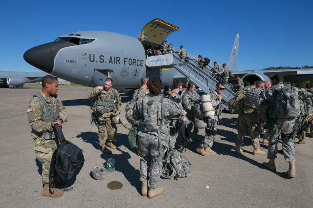 Soldiers assigned to the New York Army National Guard's 442nd Military Police Company board a KC-135 assigned to the New Hampshire Air National Guard at Stewart International Airport in Newburgh, N.Y. as they head for Puerto Rico on Oct. 1, 2017. 107 Soldiers deployed to Puerto Rico on Oct. 1 to provide security assistance there.