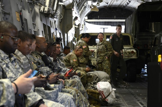 Soldiers assigned to the New York Army National Guard's 442 Military Police Company wait to be transported from Stewart Air National Guard Base, New York, to Muniz Air National Guard Base, Puerto Rico by a c-17 Globemaster III crew assigned to the 105th Airlift Wing on Oct. 2, 2017. The military policemen will provide law enforcement support to the island for an indefinite amount of time.