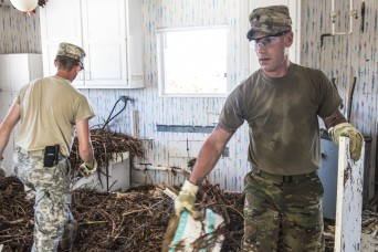 Florida National Guard clears Hurricane Irma debris from homes