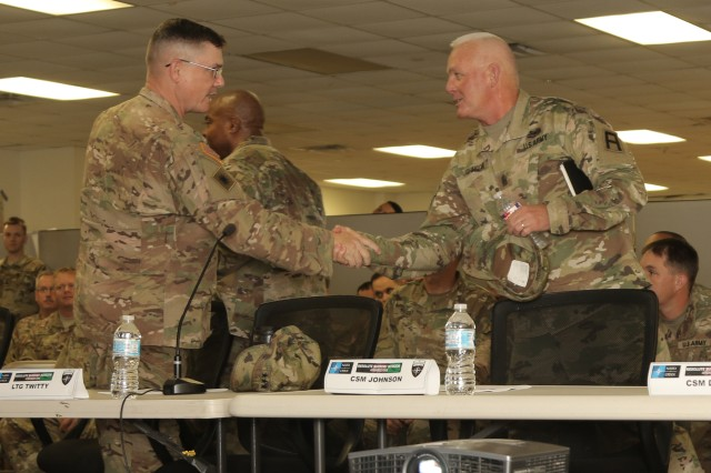 Brig. Gen. John Lathrop, commanding general of the California Army National Guard's 40th Infantry Division Headquarters Forward, shakes hands with Command Sgt. Maj. Richard Johnson, command sergeant major of First Army, during a Mid-After Action Review of a Mission Rehearsal Exercise for the 40th ID at Fort Hood, Texas, Sept. 27. A Mid-AAR enables leaders and Soldiers to take lessons learned from the training so far and apply them for the remainder of the exercise. Nearly 100 Soldiers in 40th ID Forward will deploy soon to southern Afghanistan to replace the Texas Army National Guard's 36th Infantry Division.
