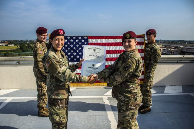 U.S. Army Paratroopers from the 173rd Airborne Brigade shake hands following a re-enlistment ceremony on Caserma Del Din, Italy.