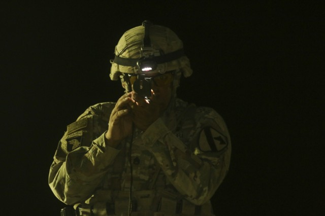"Staff Sgt. William Acosta of Charlie Company, 1st Battalion, 12th Cavalry Regiment, 3rd Armored Brigade Combat Team, 1st Cavalry Division, uses a lensatic compass to determine an azimuth at the ""call for fire"" testing station at the expert infantryman badge testing at Camp Buehring, Kuwait, Sept. 27, 2017. The expert infantryman badge is a coveted accomplishment at distinguishes infantrymen from their peers and establishes them as experts in their field."