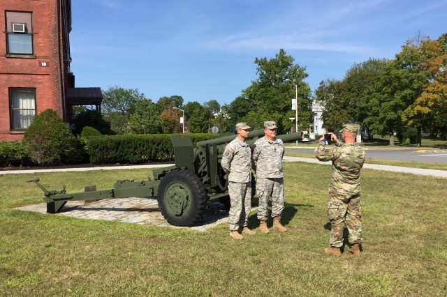 Capt. Harry Stephens, left, and Lt. Col. James Houlihan, center, are having their picture taken by Sgt. 1st Class Matt Scotten after they were interviewed by Scotten.  Scotten, who is a public affairs noncommissioned officer with the Personnel Force Innovation (PFI) headquarters in Indianapolis, Indiana, visited the Arsenal in September to draft an article for the agency's annual review report about the PFI program.