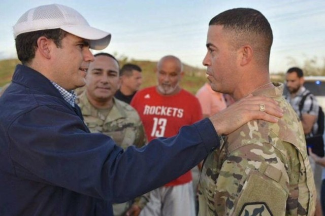 Gov. Ricardo Rossello, of Puerto Rico, thanks Staff Sgt. Jose Medina for his volunteer efforts.