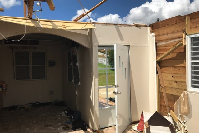 Staff Sgt. Jose Medina's home, showing the devastation caused by Hurricane Maria. The roof was blown off allowing wind to rip through the interior. Despite losing his home, Medina focused on helping his neighbors.