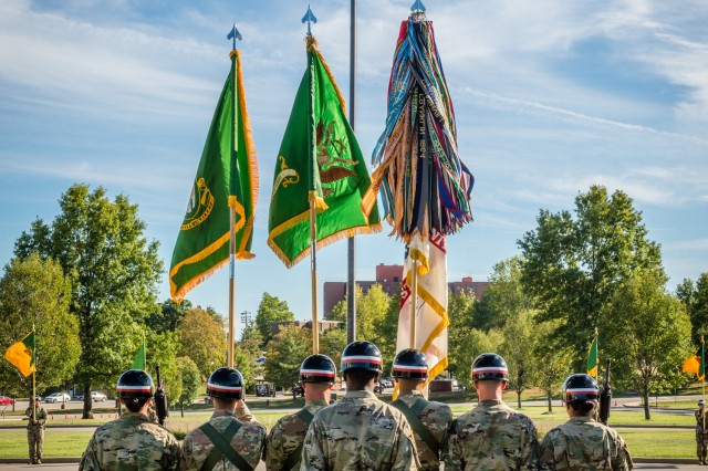 A color guard stands ready during Regimental Retreat.