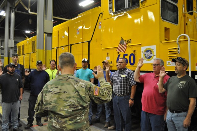 Col. Mike Garlington, Crane Army Ammunition Activity commander, swears in former Navy rail employees as new Army civilians Oct. 2 as CAAA takes over rail operations from the Navy on Naval Support Activity Crane.