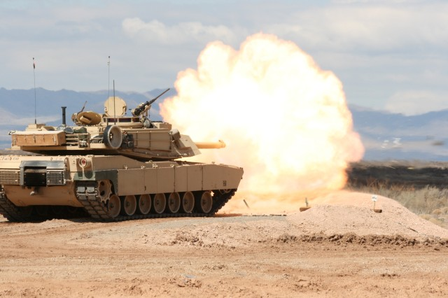 An M1A2 Abrams tank fires at simulated enemy targets during a gunnery exercise conducted by 1st Combined Arms Battalion, 5th Brigade, 1st Armored Division. The Maneuver Center of Excellence at Fort Benning, Georgia, has provisionally stood up a cross-functional team that is focused on the development of the Army's Next Generation of Combat Vehicles.