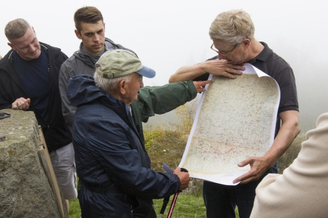 Elio Pasquale, an 83 year-old Italian local who remembered WWII and wears a 10th Mountain Division hat everywhere he goes, points out fighting positions on a map of the area at Mount Belvedere, Italy, on October 1. The group was on a tour that retraced the history of their Division by visiting WWII battlefields and signifcant sites to gain a deeper understanding, appreciation, and connection to the Division. (U.S. Army photo by Spc. Thomas Scaggs) 171001-A-TZ475-033